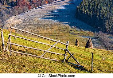 haystack on the rural field on hillside - haystack behind...