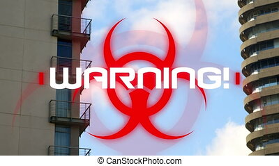 Hazard sign with warning text against against tall buildings...
