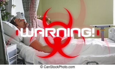 Animation of a red biological hazard icon with white word WARNING! with a Caucasian male patient lying on hospital bed in the background. Coronavirus Covid-19 pandemic concept digital composite.
