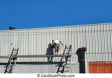 Hazardous Conditions - Man works from high scaffolding spray...