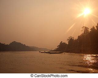 Haze over Borneo river, flare intentional