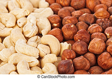 Hazel and cashew nuts food background