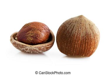 Hazelnut - Closeup of whole and cracked hazelnuts. Isolated...