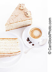 hazelnut cream cake from top with a cup of coffee on white background