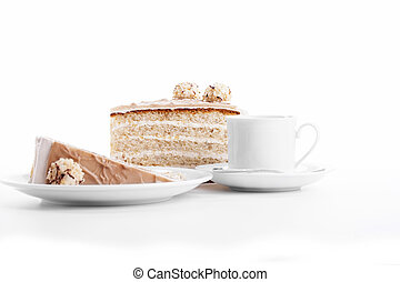 hazelnut cream cake with a cup of coffee on white background