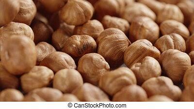 hazelnut falling in 4k, prores footage 60fps