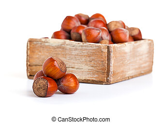 hazelnut in the wooden box. on white background