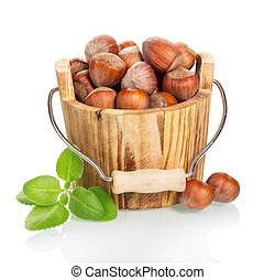 Hazelnut in the wooden bucket isolated on  white background.