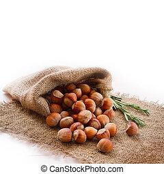 Hazelnuts, filbert on old wooden background