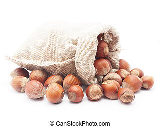 Hazelnuts in a bag on a white background