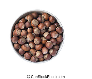 Hazelnuts in a bowl isolated on white background, top view.