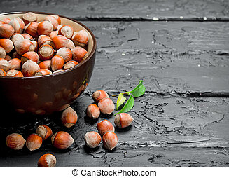 Hazelnuts in the bowl .