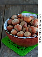 Hazelnuts in the ceramic bowl