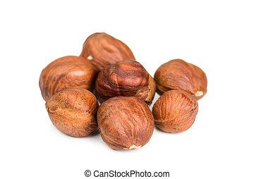 Hazelnuts isolated on white background, close up