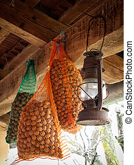 Sacks filled with hazelnut under the roof.
