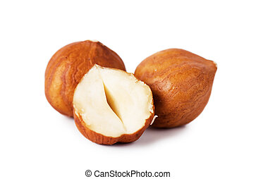 Hazelnuts - Closeup view of hazelnuts over white background