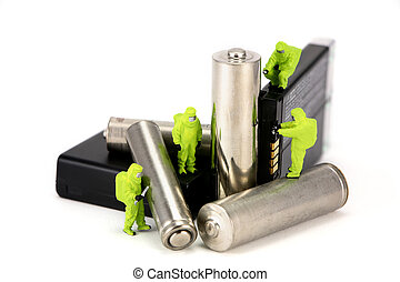 HAZMAT team disposing of or recycling old batteries -...