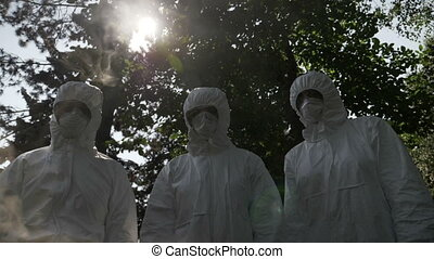 Hazmat technician engineers workers covered with protection...