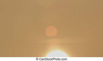 hazy defocused sun