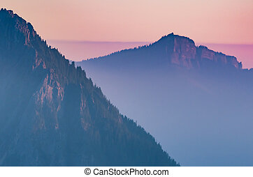 Hazy Purple Sunset Over Cascade Mountains at Dusk