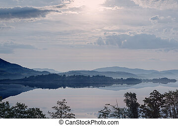 Hazy Sunrise in mountain lake