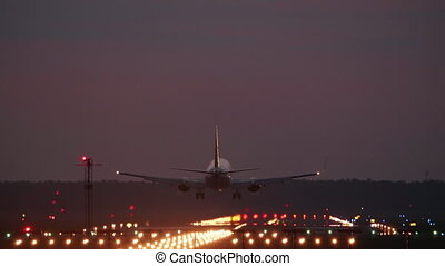 HD - Airplane landing at night on airport runway