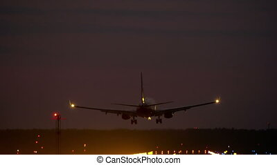 HD - Airplane landing at night on runway