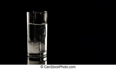HD - Aspirin in a water glass. Slow