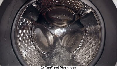 HD - Camera moves to inside the washing machine. Slow-mo