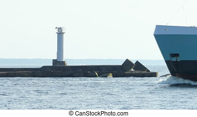 HD - Cargo ship passes near the lighthouse