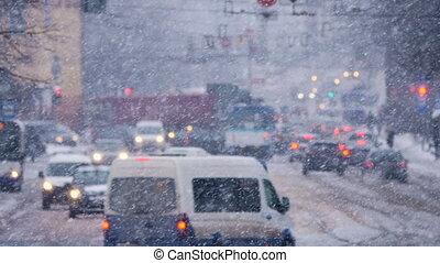 HD - City traffic in winter. Snowfall
