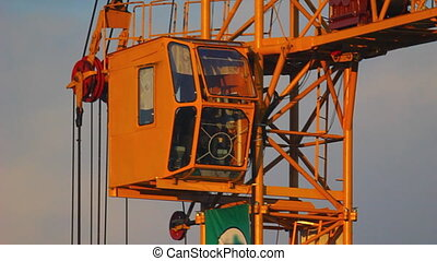 HD Close-up of working tower crane at sunset