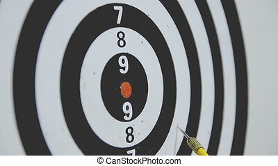 HD-Close up shot of yellow and red dart arrow hit the dartboard