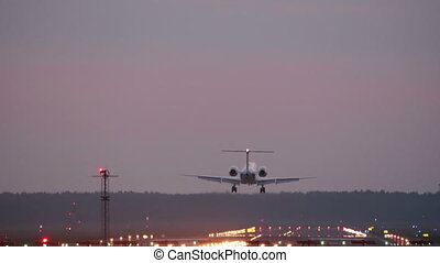 HD - Commercial Jet Airplane landing at sunset on runway