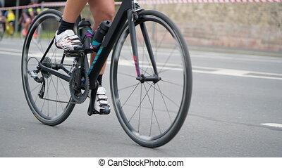 HD - Cycling wheels on city marathon. Slow motion
