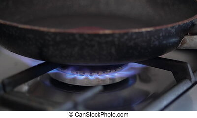 HD - Fire ignition under the frying pan on the gas stove