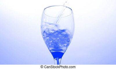 HD - Glass of blue water bottom vie