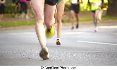 HD - Marathon athletes legs. front view