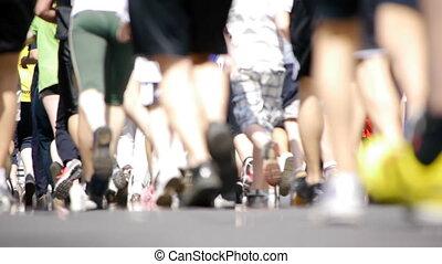 HD - Marathon. Feet of people