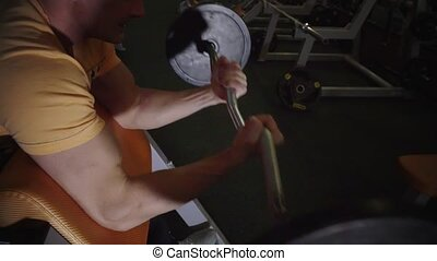 HD Muscular middle age man doing exercise in gym 16