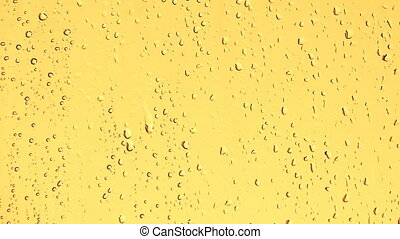 HD rain water drops on the golden surface