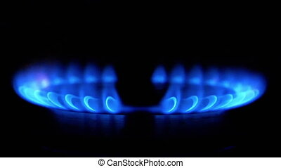 HD - Slow ignition of a blue flame on gas stove