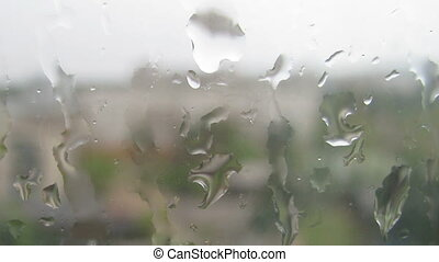 HD Timelapse of water drops on window glass during the rain
