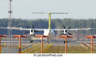 HD - Turboprop aircraft on a runway