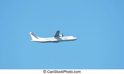 HD - Turboprop airliner in the sky