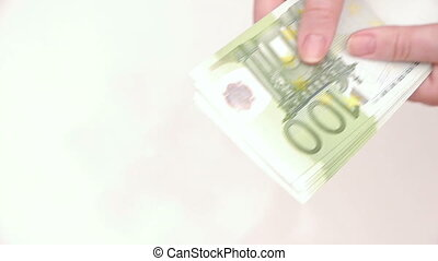 Woman counting money. Euro