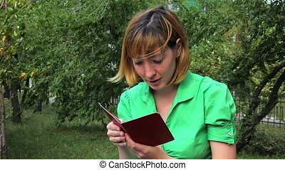 HD Young girl reading book