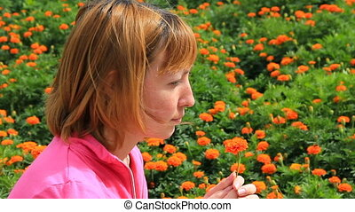 HD Young girl with marigold flower