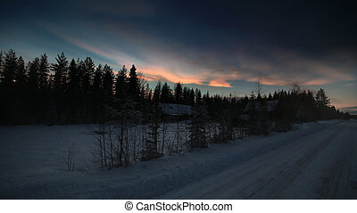 HDR image of nacreous clouds over Swedish farm buildings in winter