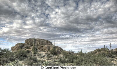 HDR Timelapse Javelina Rocks Saguaro NP Arizona with clouds...